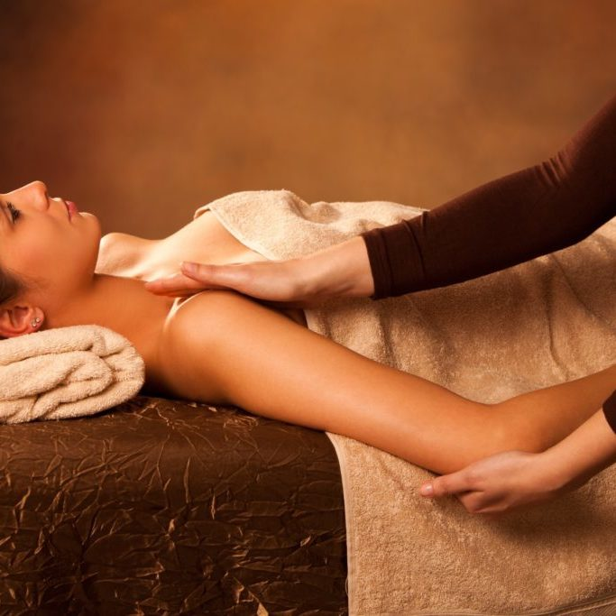 woman enjoy in  arm  massage in spa